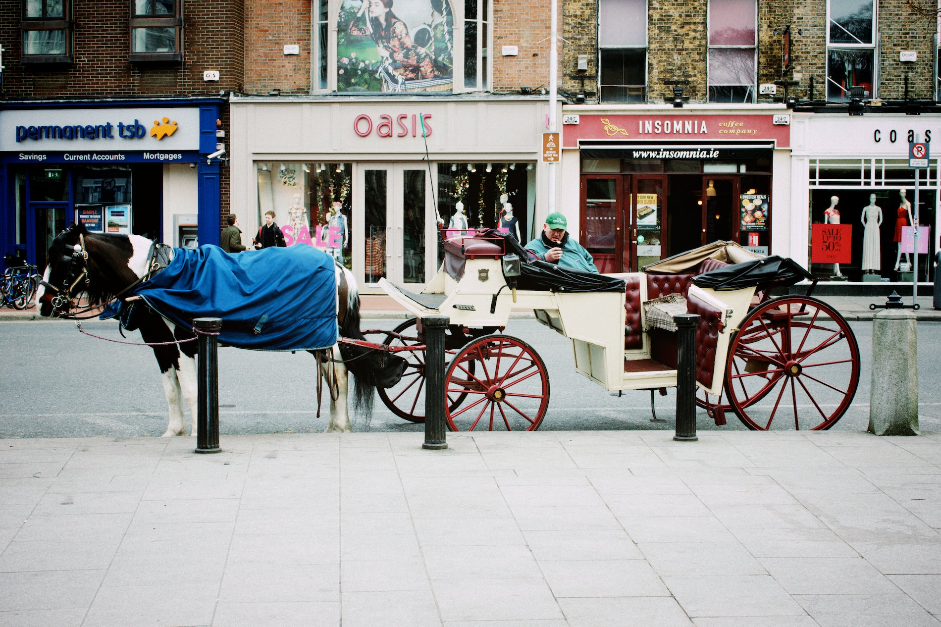 Horse and cart driver on smart phone