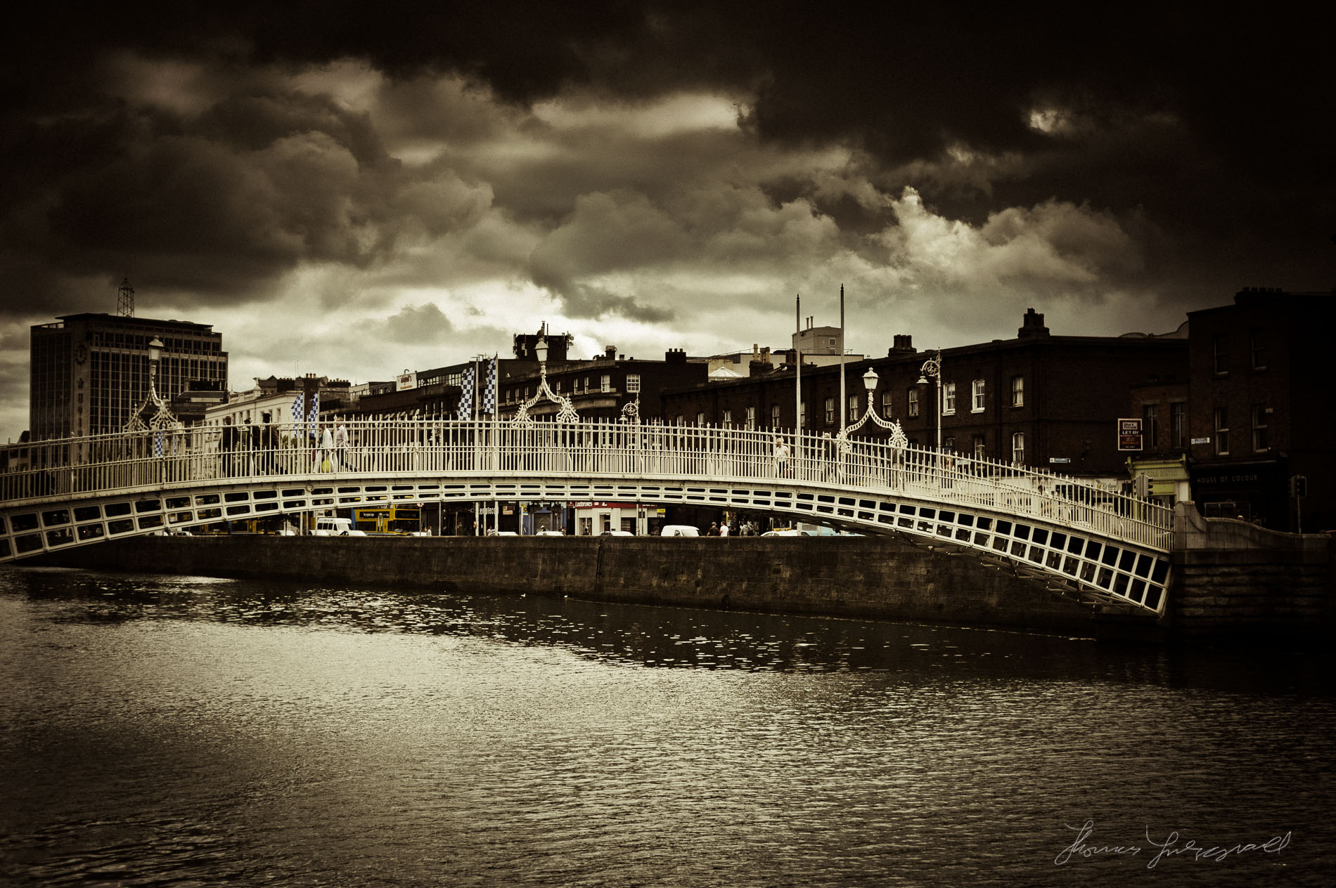 Ha'penny Bridge under a Moody Sky