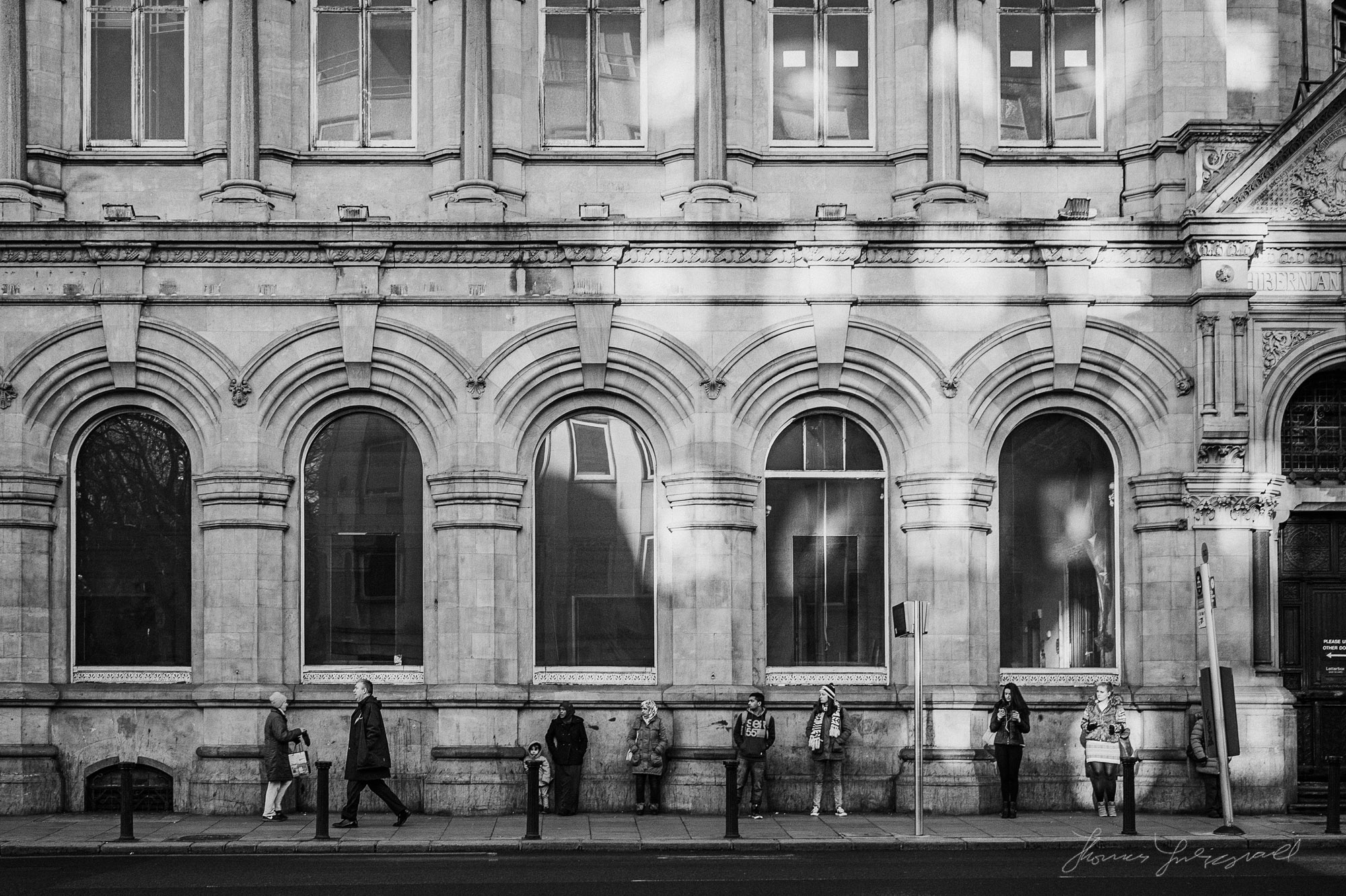 People Waiting for the Bus Stop on Dame Street I always love thi