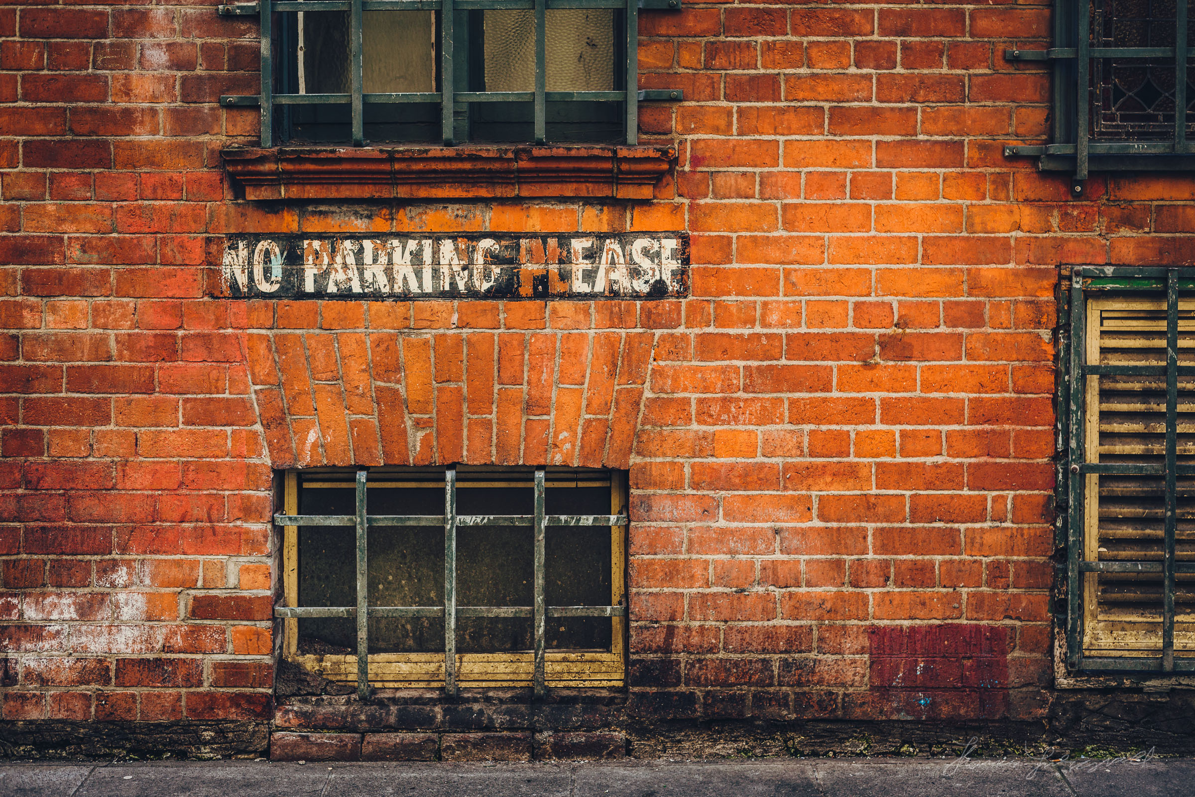 No Parking Please text on a Wall