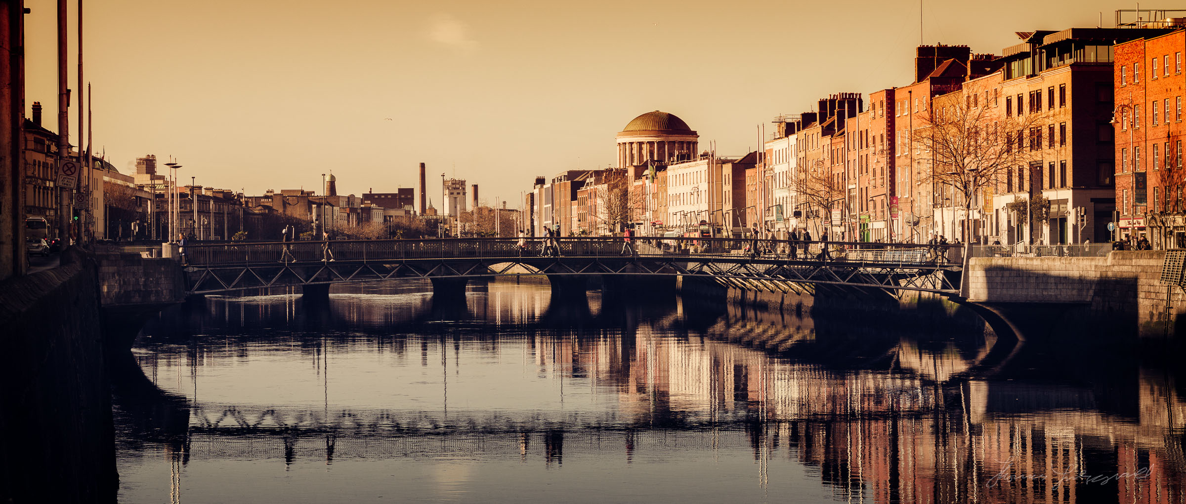 The Low Sun over the gentle waters of the Liffey