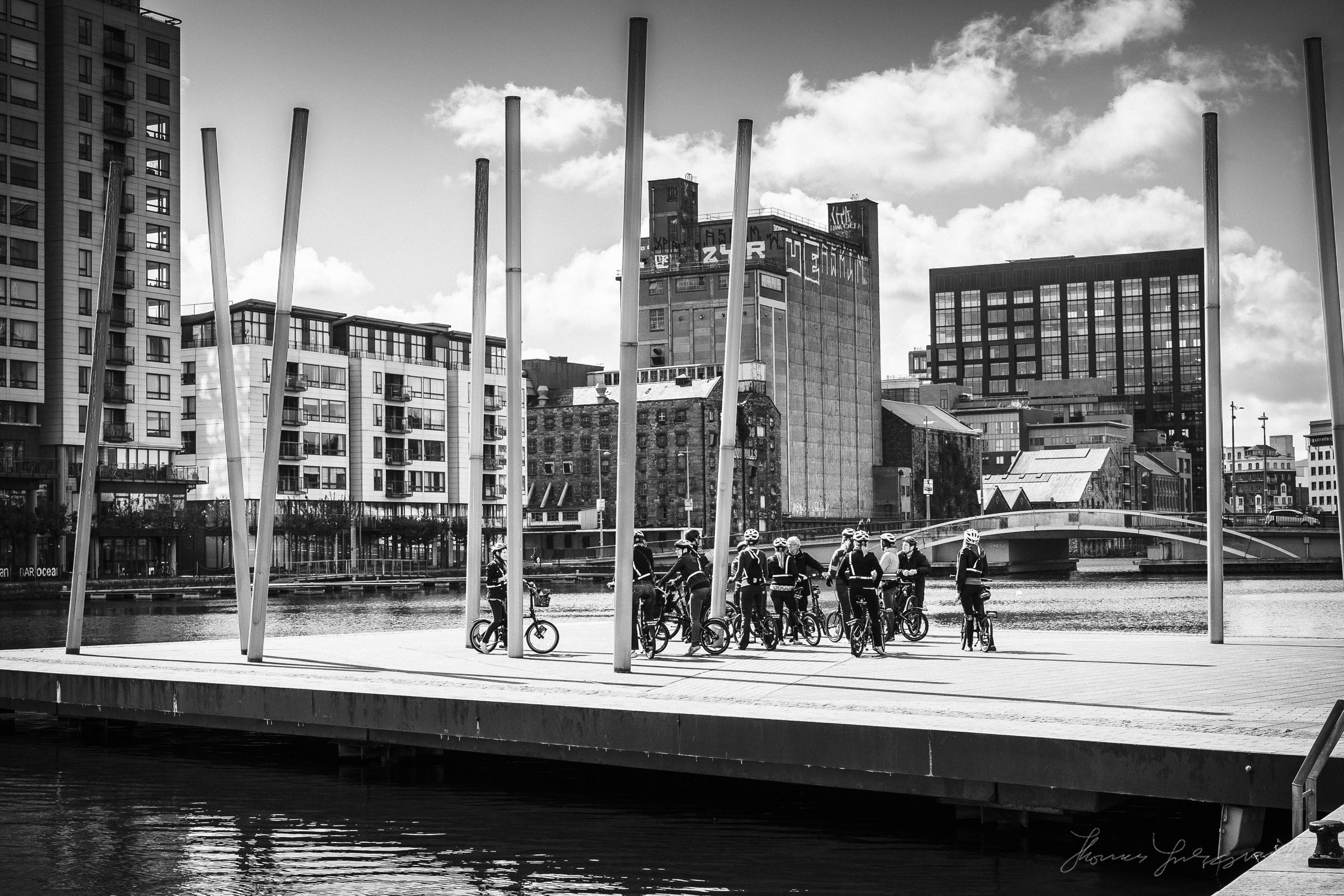 A Cycle tour stops to examine the docklands