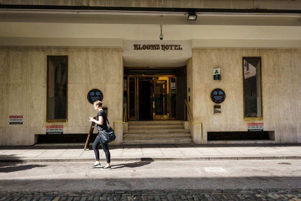 A person Walks by the Blooms Hotel in Dublin