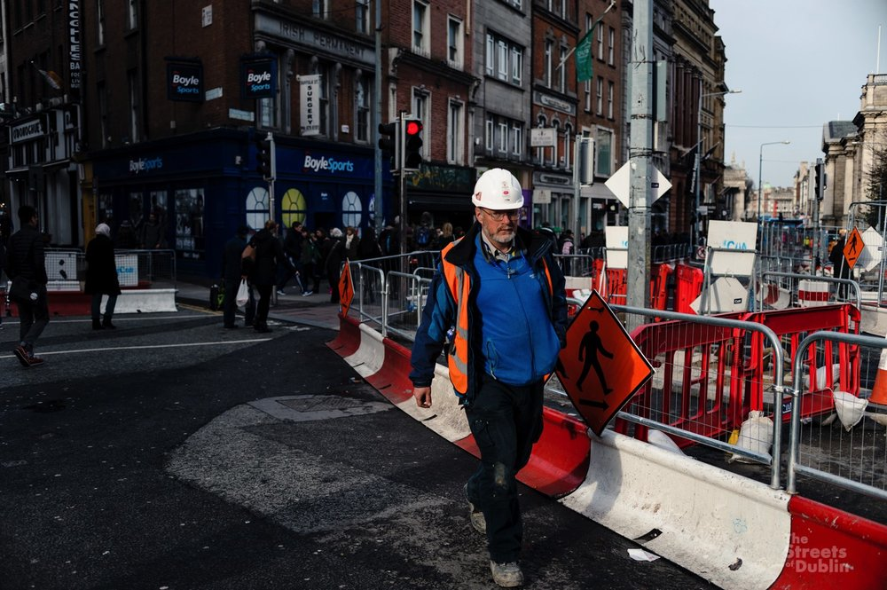 Worker in front of Luas construction Site