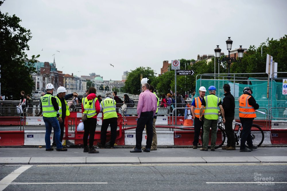 Examining the Tracks on O'Connell Bridge