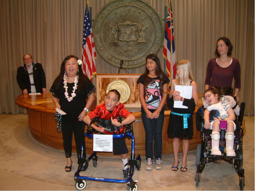 "Kainalu Elementary School's Special Education teacher, Shann Peterson explains the ""Special Friends"" Program to all of the attendees at the Governor's E Ola Pono Proclamation"
