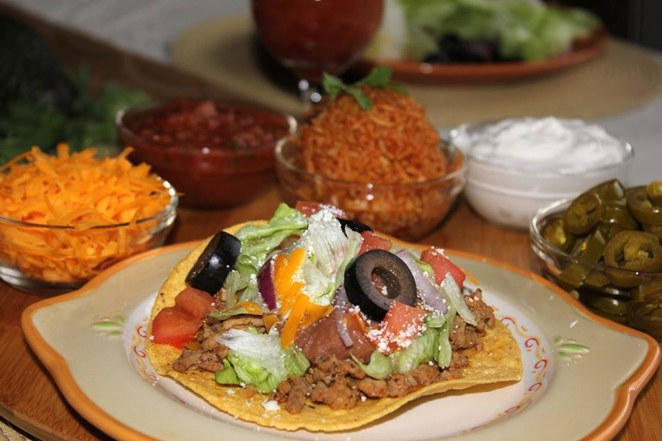 Ingredients:  1 package (20 ounces) lean ground turkey  1/2 cup chopped onion  1/2 cup chopped green pepper  1 teaspoon canola oil  3/4 cup water  1 envelope taco seasoning  1 can (15-1/2 ounces) hominy, rinsed and drained  12 tostada shells  3 cups shredded lettuce  1 cup (4 ounces) shredded Mexican cheese blend  1 cup chopped tomato  1 cup cubed avocado  Directions:  In a large skillet, cook the turkey, onion and green pepper in oil over medium heat for 5 minutes or until meat is no longer pink; drain. Stir in the water, taco seasoning and hominy. Bring to a boil. Reduce heat; simmer, uncovered, for 5 minutes or until heated through.  On each tostada shell, layer the lettuce, about 1/3 cup turkey mixture, cheese, tomato and avocado.Yield: 6 servings.  Recipe - Taste of Home