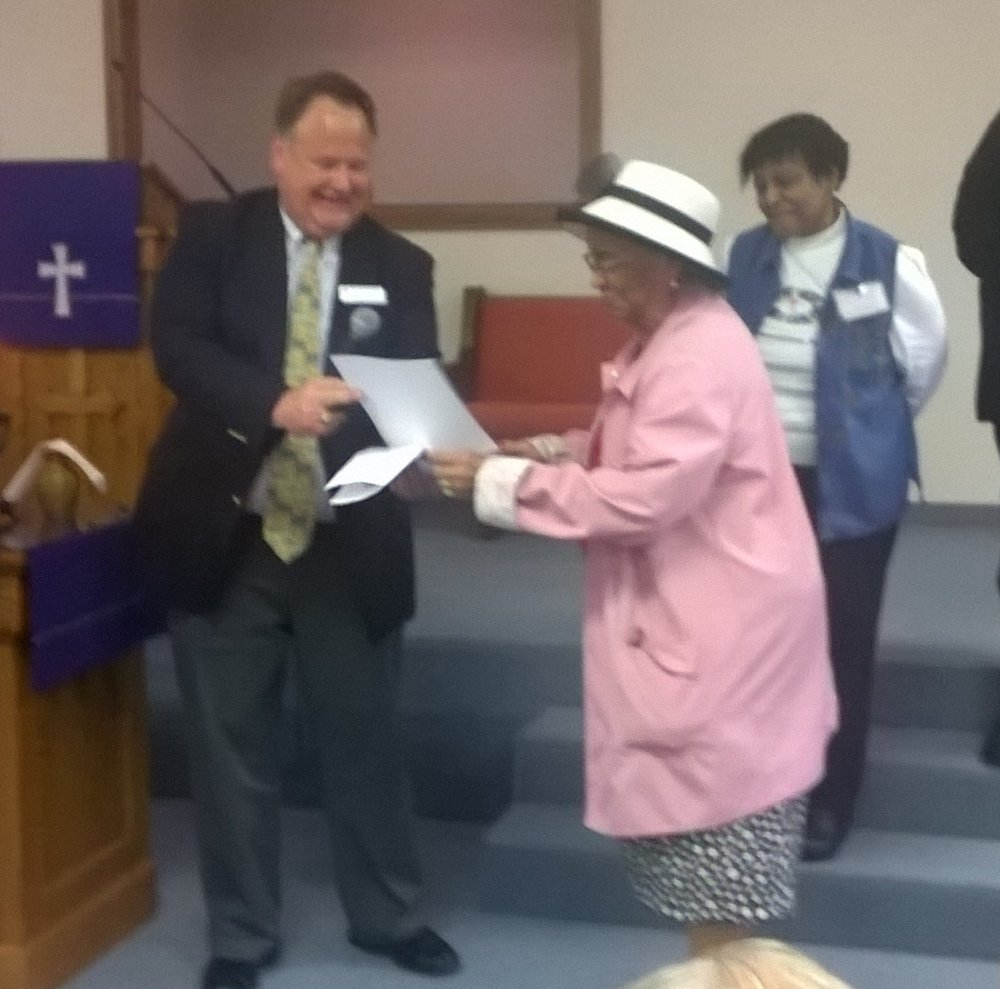 Presentation to Rev. Faye by Rev. Dr. Paul Koch