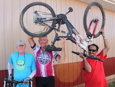 Mayor Pro Tem Randy Bland, deCycles Director Dr. Norm Houze, and Rev. Jack Daniel (Holding up the pastor's bike that isn't proper for cross country riding…but made it through town.)