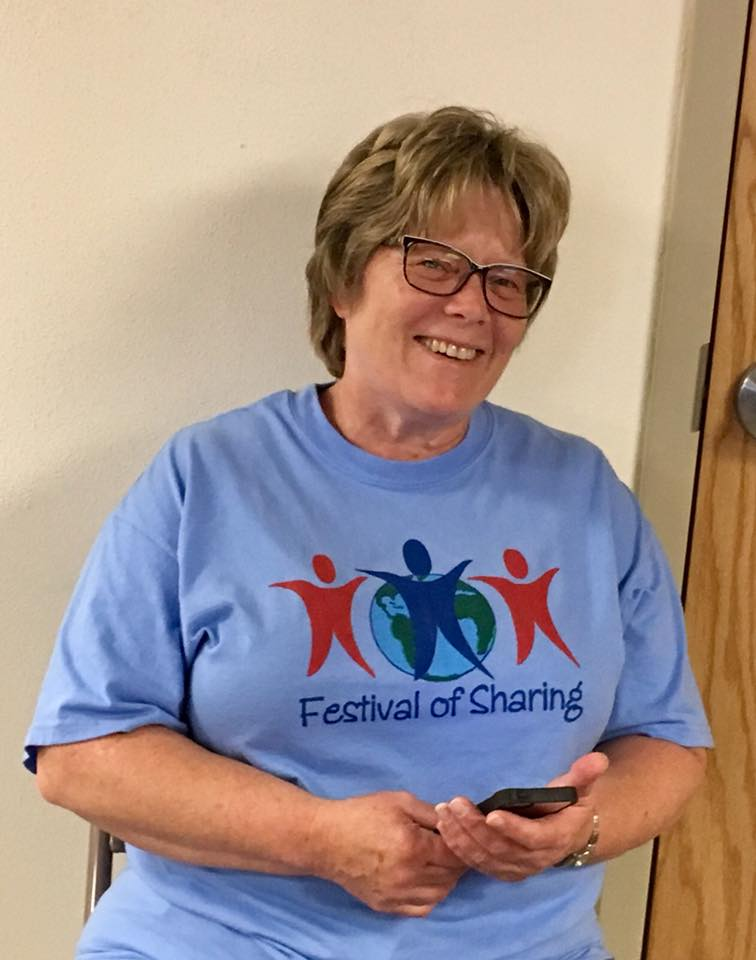 Karen Stoll, heading the project for Cathy Hankins who organizes the event and had to work, but giving a nod to Festival of Sharing all day!