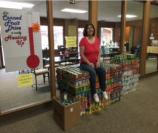 "The church newsletter shared this photo of ""The Queen of Canned Fruit perched on her throne."""