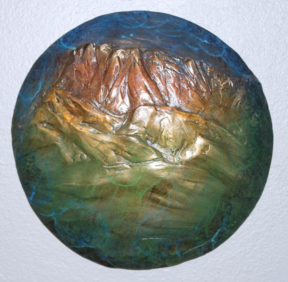 """RUBY PEAK"" bronze 8"" diameter $275."