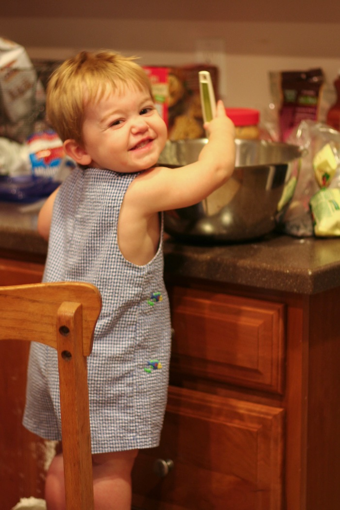 toddler stirring in bowl in kitchen