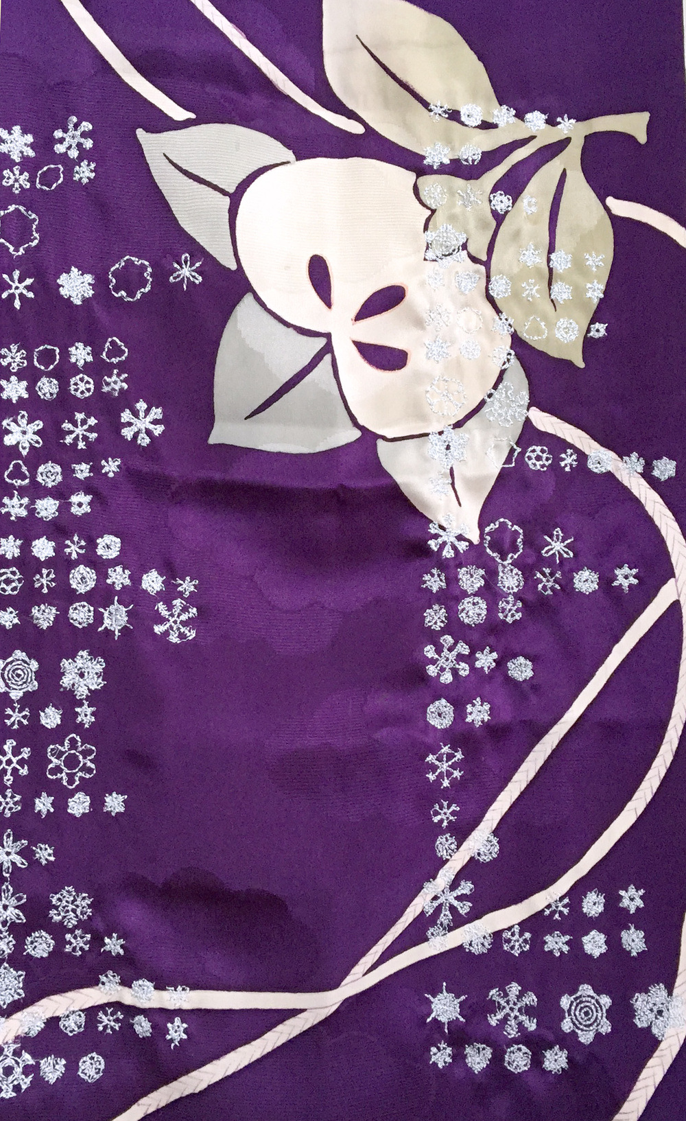 Amiko Matsuo Detail of digital embroidery of snowflake data since 1959 stitched on vintage kimono silk.