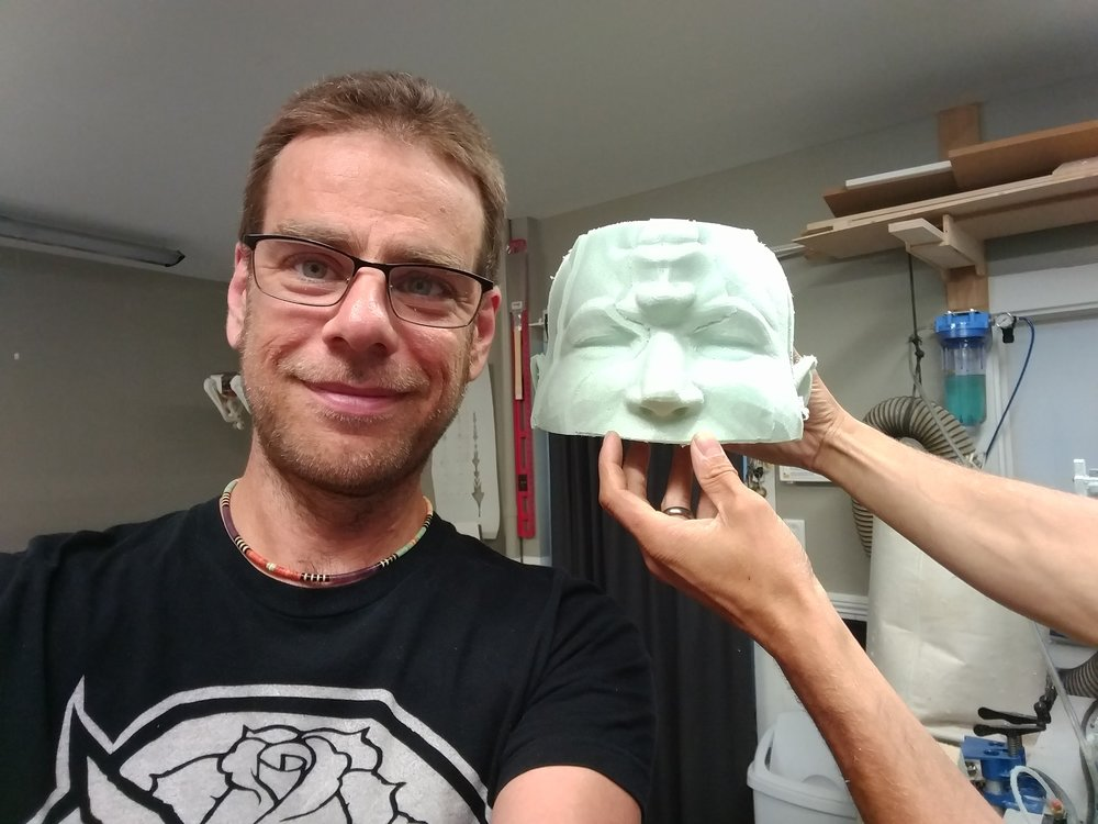 Artist Patrick Manning at Digital Fabrication Residency 3 Day Program with a section of a life size sculpture tested in foam cut on our CNC router.