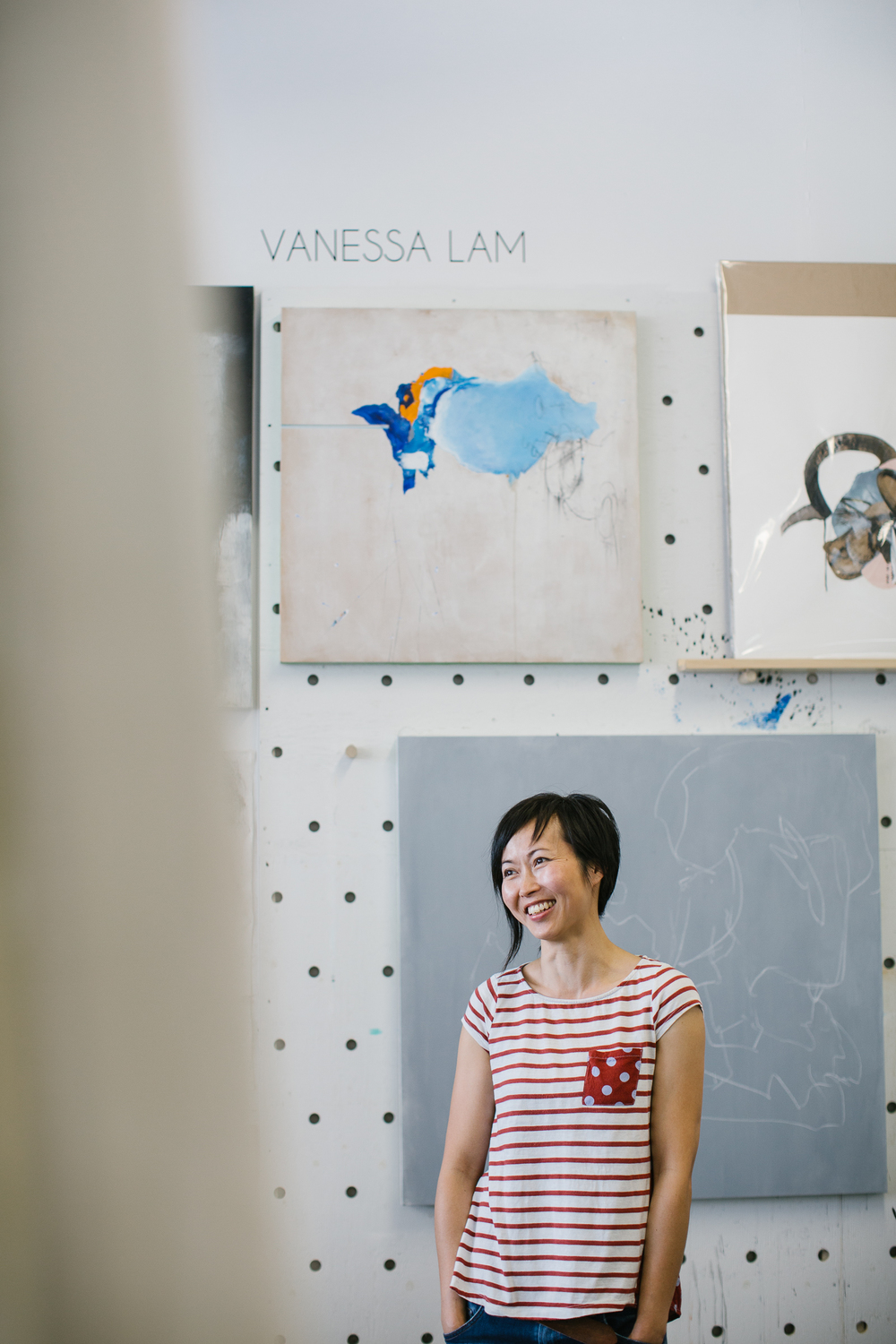 Portrait of Vancouver mixed media artist  Vanessa Lam  in her studio.