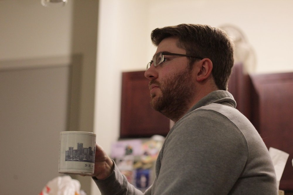Writer/Producer Billy drinks from a Seattle mug, dreams of Seattle.
