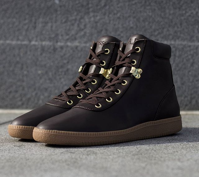 The Fulton (brown) features a smooth calf pull up leather upper with full leather inside lining. A gum colored GAT outsole and shiny gold plated hardware accentuates this sleek boxing boot inspired sneaker.  These are perfect to rock during the greyed out sky days of NY's fall & winter months. Subtle but substantial.