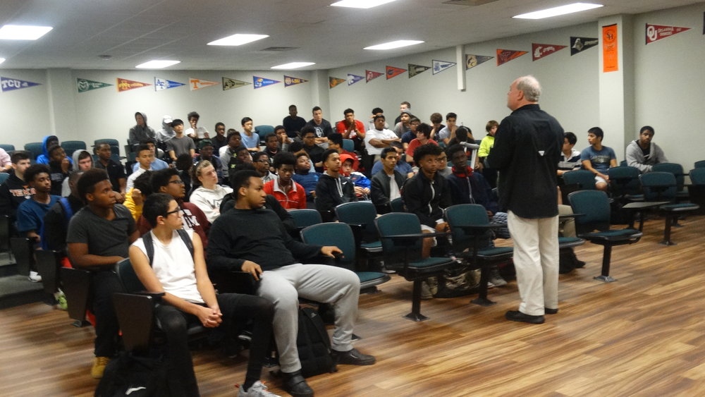 Coach Ledford reinforcing the mankindness project  curriculum's message to berkner high school athletes.