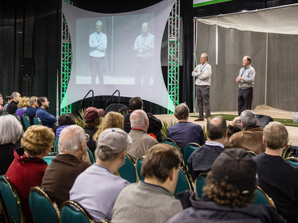 Crowd listening as Mark Rolfing (left) and Jeff Sluman (right) take the stage