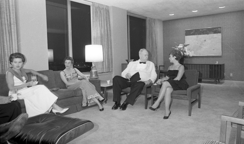 Albert G. McCarthy Jr. entertaining guests in his new high rise penthouse apartment in the BB&T Building. N&O  Businessman 'At Home' 14 Floors Above Raleigh , June 10 1965