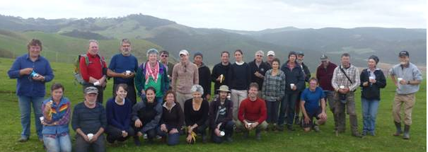 Rivercare volunteers pose for a photo at Parihoa Farm after a morning planting 1,000 native trees on the Te Henga Wetland. 28 June 2014.