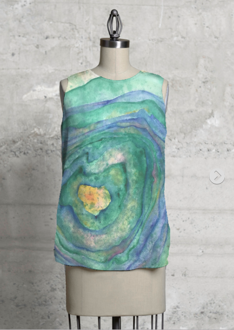 ENCHANTED ROCK  Asymmetrical Sleeveless Top      Click here to purchase   A portion of proceeds go to  Literacy for Life  via Shop Vida