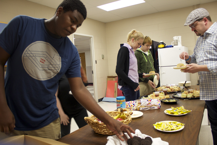 Lighting director Myles Roddy (foreground) and some of the other crew members enjoy dinner provided by the Poplar Pike Arts Guild.