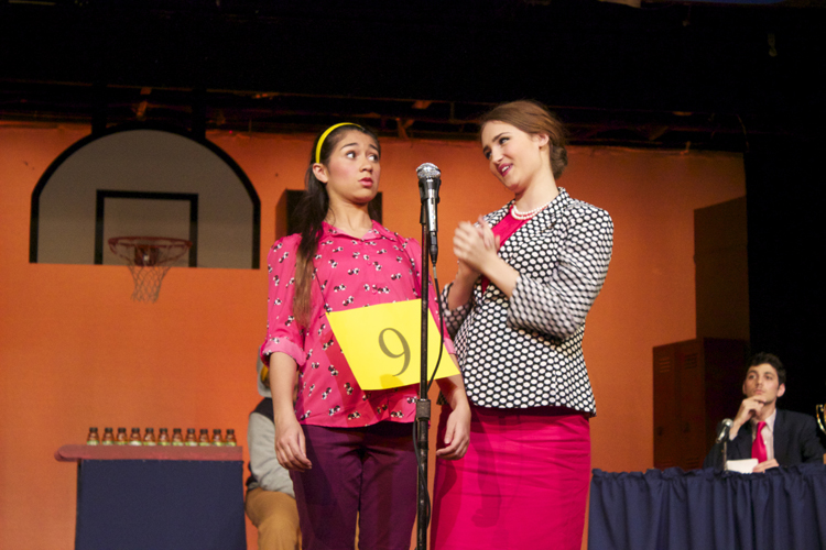 Perretti shows Ostrovsky how a spelling bee champion is supposed to stand. And she should know, Perretti won the 3rd annual Putnam County bee.