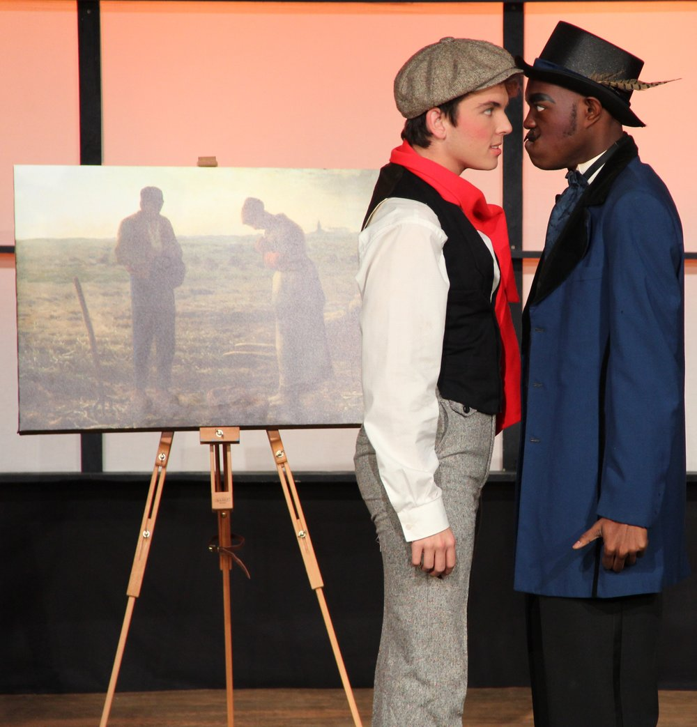 Millet (Kyle Bowers) confronts Andre (Rodney McKinner) about Millet's misfortune