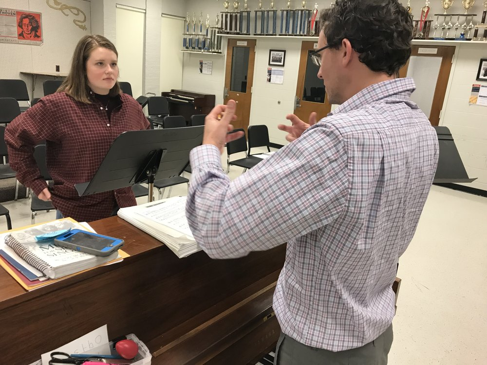 Music Director Matthew Hayner works with Scarlett Simpson (Beggar Woman) her operatic tone.