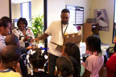 100.3 The Beat Promotion Director Leonard McGee Hands out goody bags