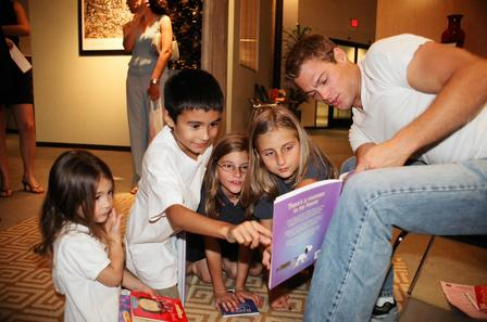 "WB ""7th Heaven"" star George Stults (Officer Kinkirk) reads a Halloween story to the children at EAF Book Fair."