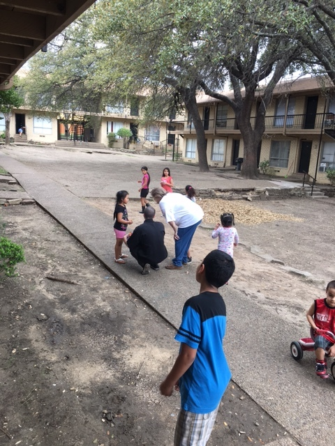Daniel giving candy to kids after the class