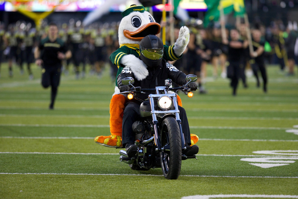 This would've been a lot more badass if the duck was actually driving the bike, but I understand since that poor student probably can't see out of that giant head anyways. And is dying of dehydration.