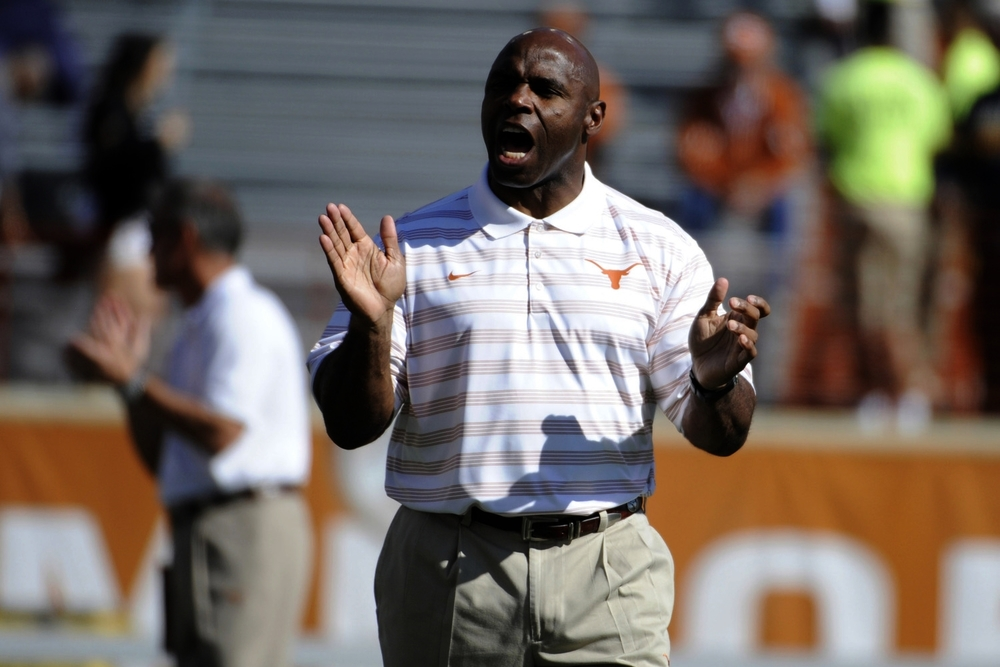 Charlie Strong not wearing a turtleneck? Truly, I have seen it all. Now I can die in peace.