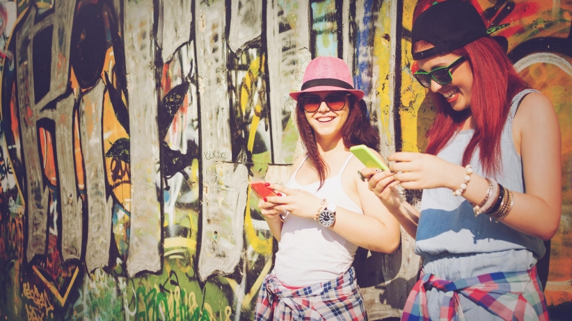 20150406154047-millennials-teenagers-girls-smartphones-texting-women-graffiti-wall-friends-hipsters-happy-young.jpeg