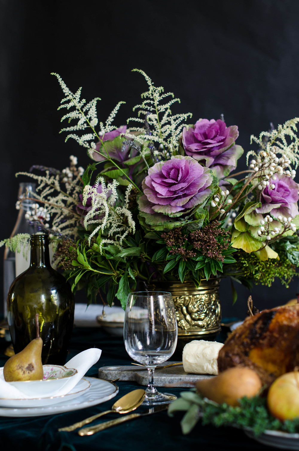 Cabbage rosettes, tallow berries, French lavender and white Astilbe come together to create a rich floral bouquet