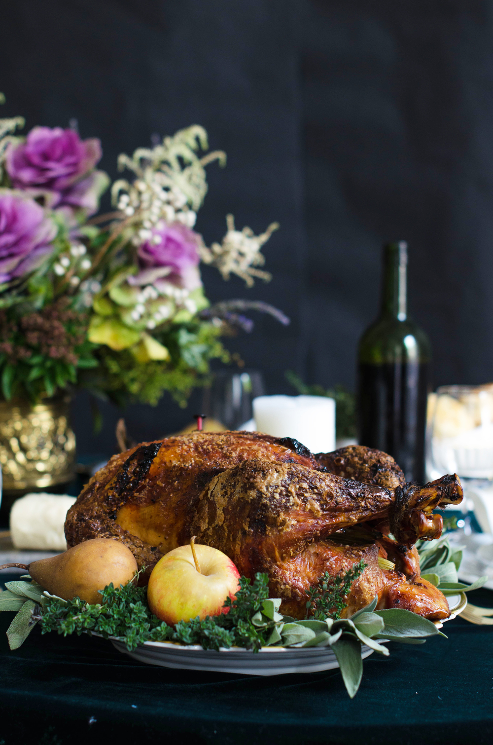 Maple Glazed Turkey garnished with fresh herbs and fruit