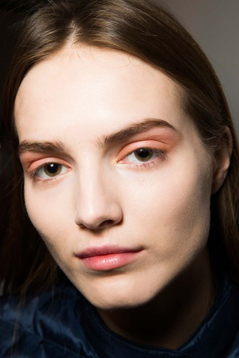 Thakoon - A soft hue of orange brushed on the lids