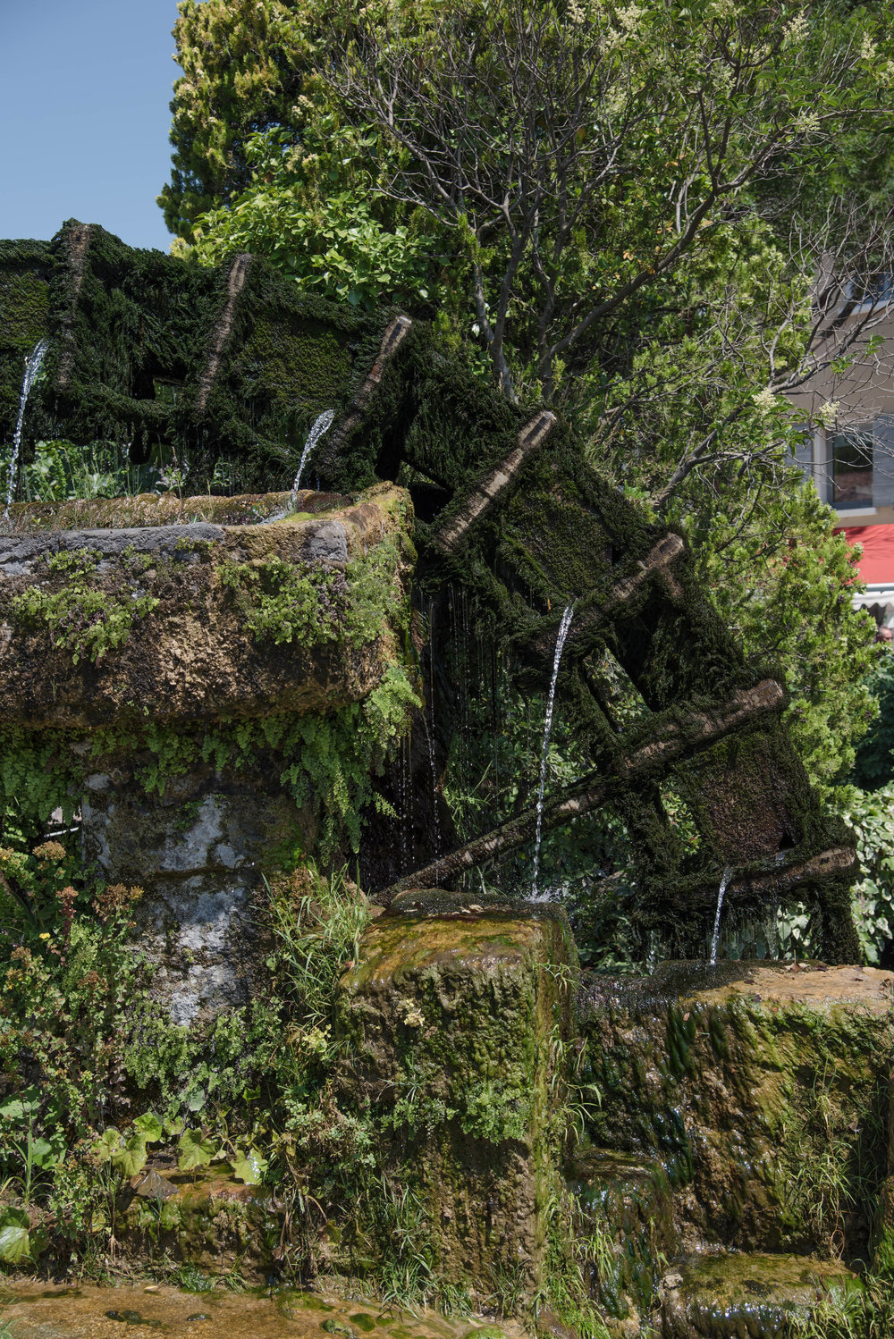 One of the moss-covered mill still gently churning the water from the river.