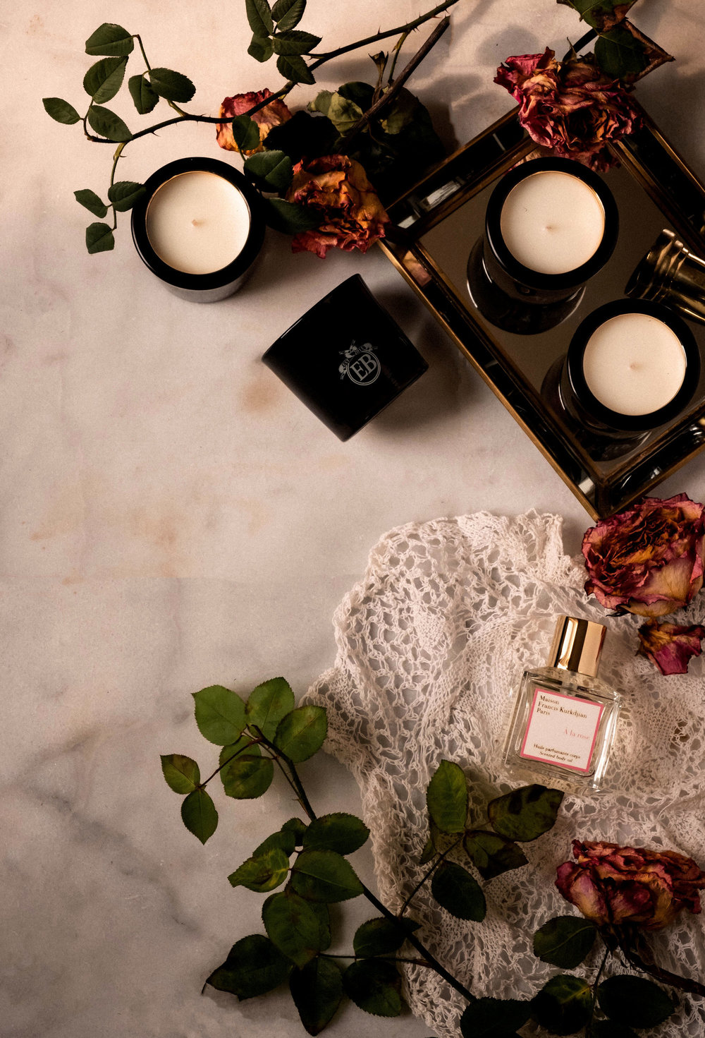 ROSE+&+IVY+Journal+Holiday+Gifting+A+Guide+of+Flowers+&+Botanicals+Maison+Kurkijan+A+la+Rose+Oil+and+Eric+Butterbaugh+Candles.jpeg