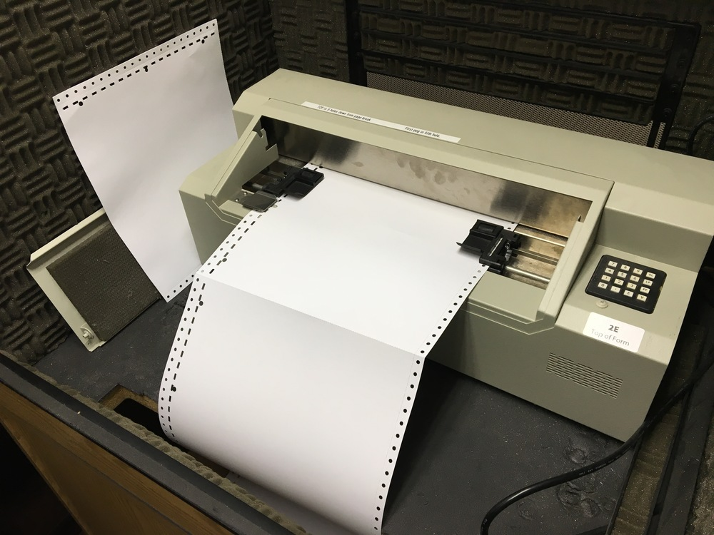 Braille labels being printed from Library for the Blind and Physically Handicapped