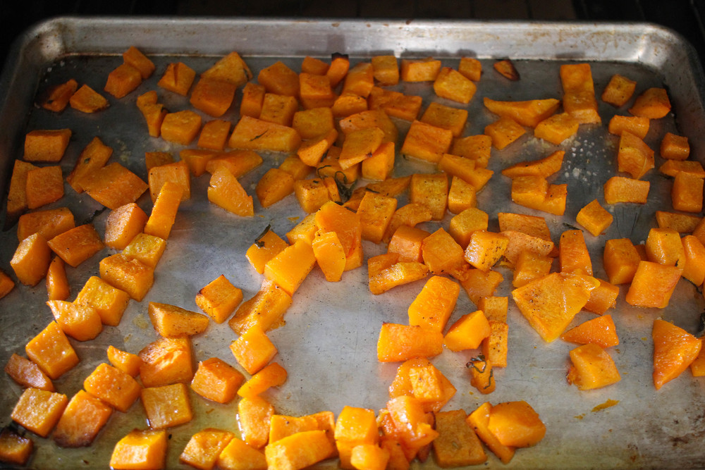 Butternut Squash 25 minutes into roasting, tender but not browned...except for the piece on the lower left corner... he got burned to a crisp because I did not move him out of the corner!