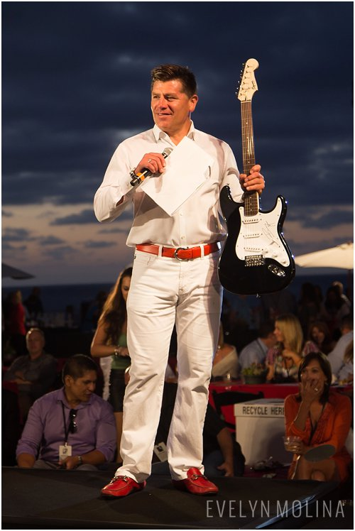 Auctioning off a Bruno Mars autographed electric guitar.