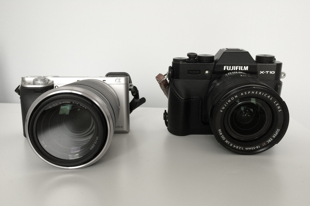Sony A6000 (with a long zoom lens) and Fujifilm X-T10 (in a leather half-case)