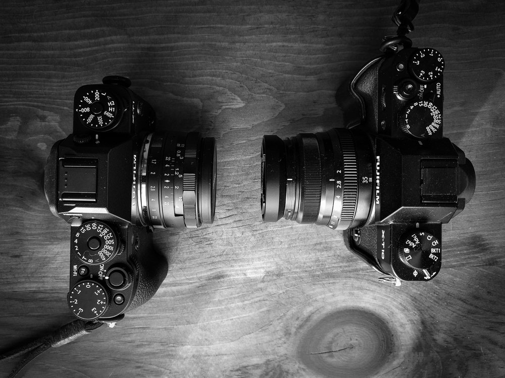 X-T1 with Neewer 35mm, X-T10 with Fujinon 35mm (including lens hood)