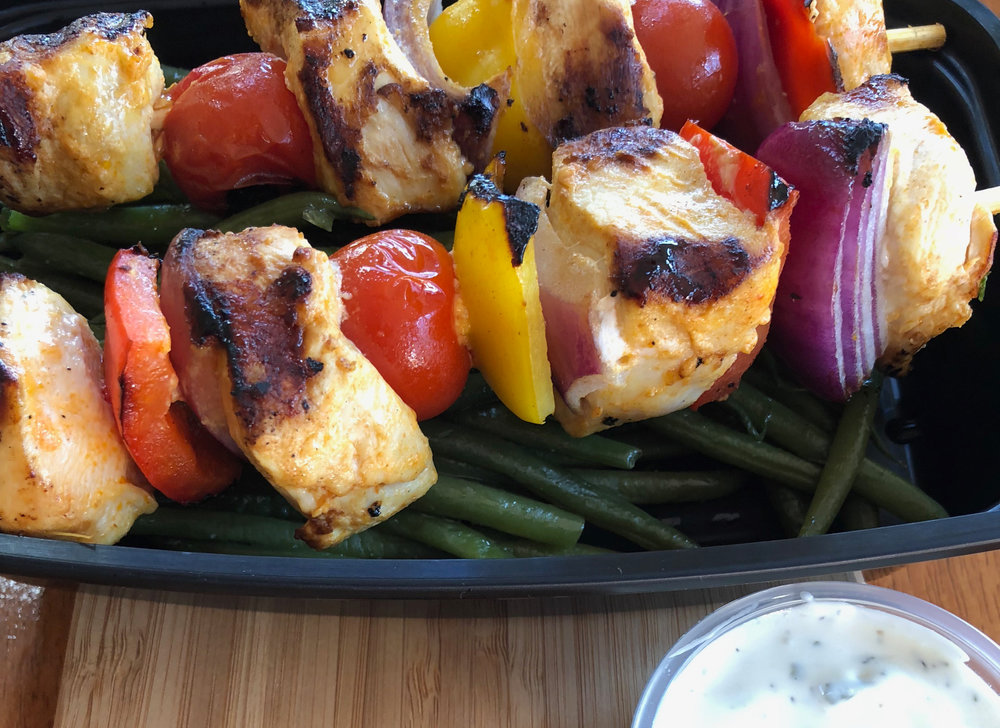 Buffalo chicken kabobs over green beans