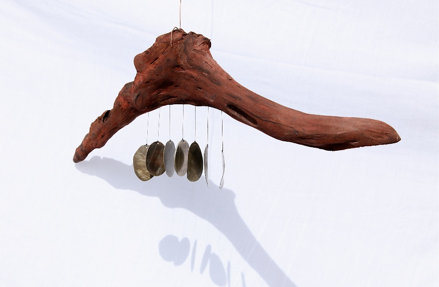 B 68 - Hollow Compass Art Marion Holmes Wind chimes made out of bone, metal, wood, and sea gull quills