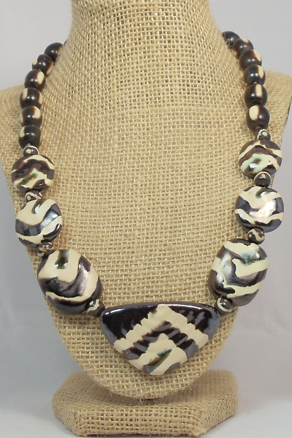 B 52 - Kuumba                                                Sadarryle Rhone Jewelry incorporates handmade recycled paper beads and fair trade beads from various groups.